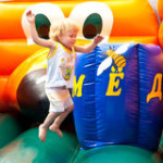kids party child-jumping-bouncy-castle-15099096